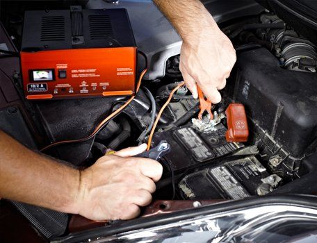 A car battery being checked