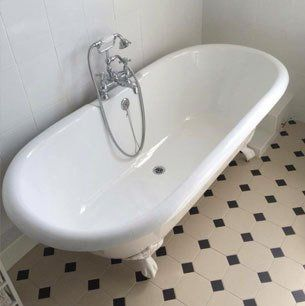 floor standing traditional bath with side taps