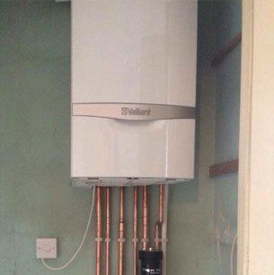 vaillant boiler with hot water pipes