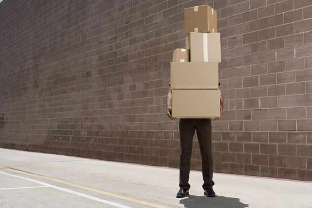man carrying boxes to storeroom in Goshen, OH