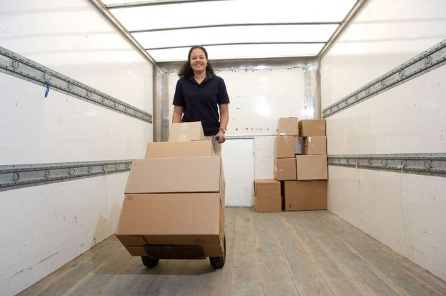 woman unloading boxes for safe storage in Goshen, OH