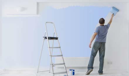 A man painting walls