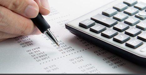 man crosschecking calculations
