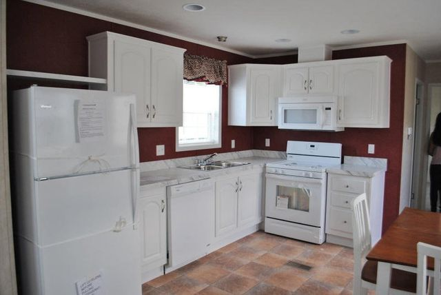 SOLD 2016 Redman 14x52 2 bedroom  1 bath White kitchen  Americana decor   very cute and cozy home Lot Model SOLD Palmer Sale Price  35 900. New Display Homes