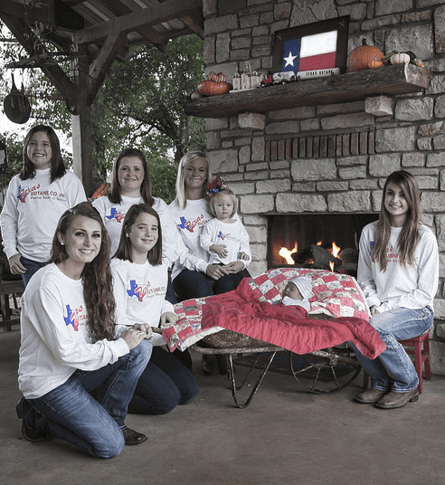 Texas Butan team by the fire