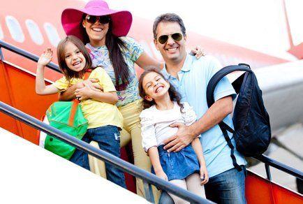 a family alighting from flight