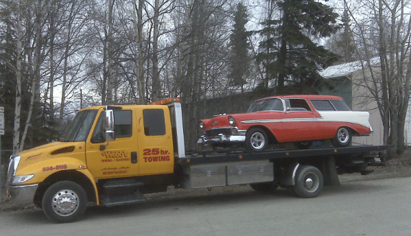 A car being towed with auto towing services in Anchorage, AK