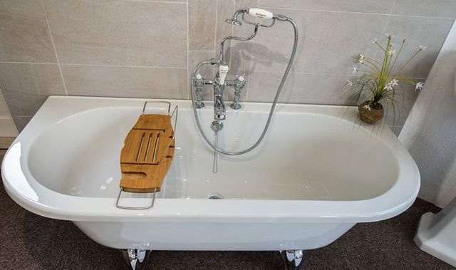 A bath with a tray across it