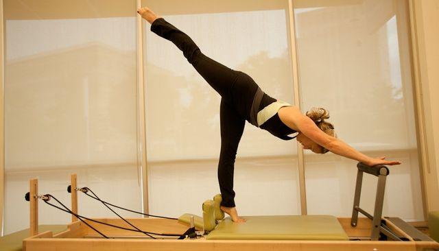 Amy de Sa using Pilates equipment at Pilates Denver