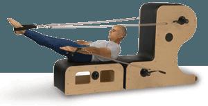 Man using Pilates equipment