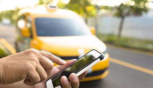 Customer booking taxi service using a smartphone in Newport, KY