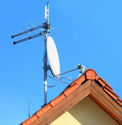 Antenna and dish on roof top