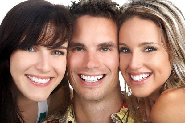 3 people with healthy smiles
