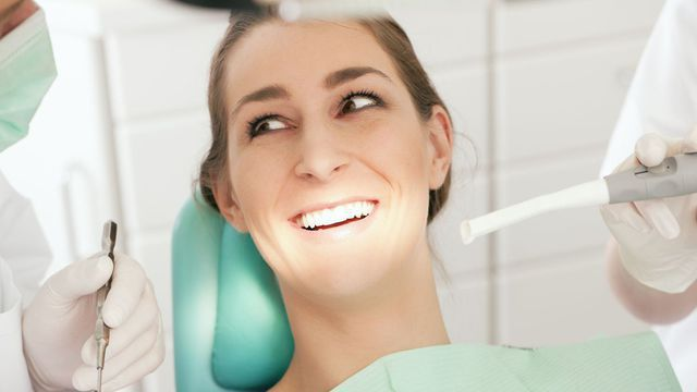 Lady smiling to see dentist