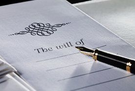 A fountain pen on top of a will