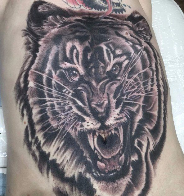 Tattoo of a tiger face