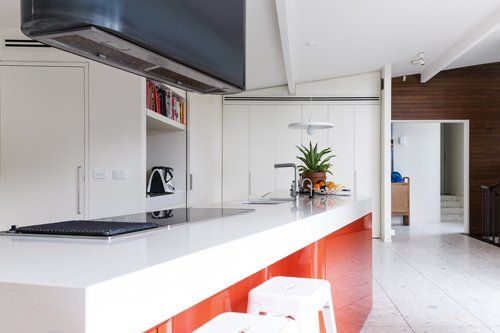 View of a red and white modular kitchen
