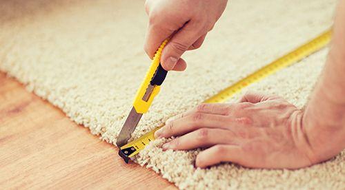 Expert measuring and installing a carpet in Oamaru, NZ