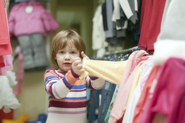 Girl looks at clothing in a shop that funds job support programs in Kingman, AZ
