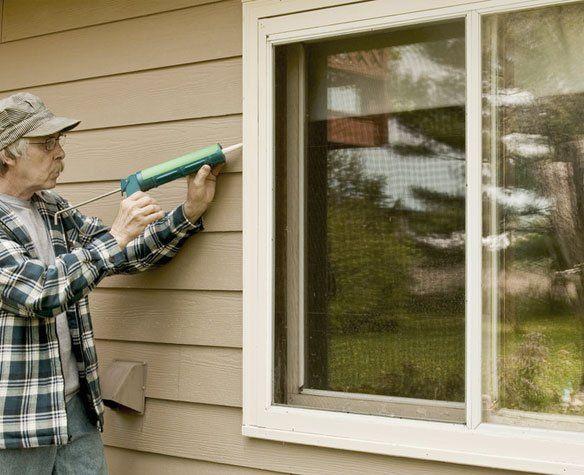 A man fitting window