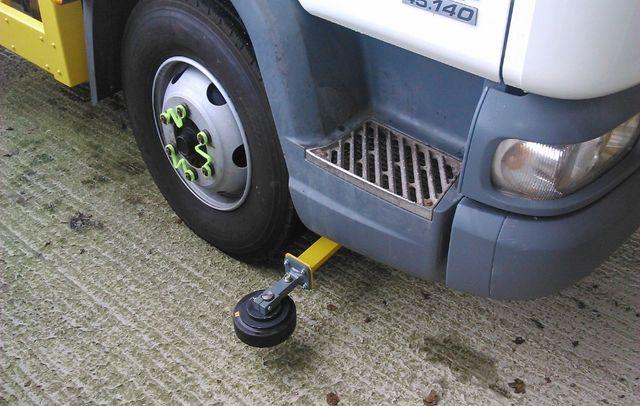 Gritter truck steering arm