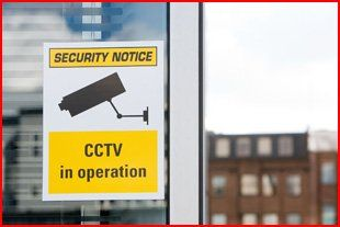 A sign reading: CCTV in operation