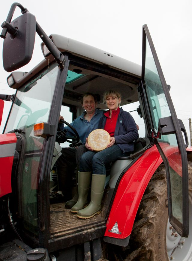 Julie and Trevor Howe in their tractor with one of their cheeses, at their farm in Ponsanooth, Cornwall. 19.10.15