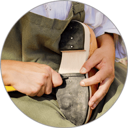 Man Stitching Shoes - Shoe Cleaning and Repairs in Wayzata, MN