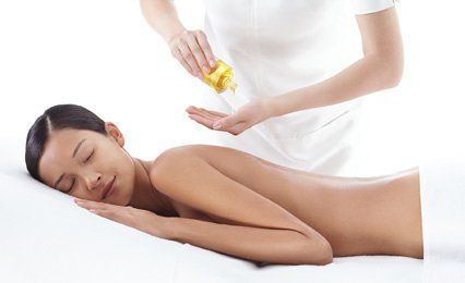 female model having back massage
