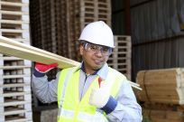 A construction worker using lumber in Crivitz, WI