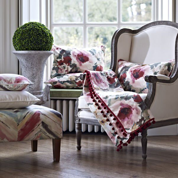 Fabrics draped over a chair with matching curtains