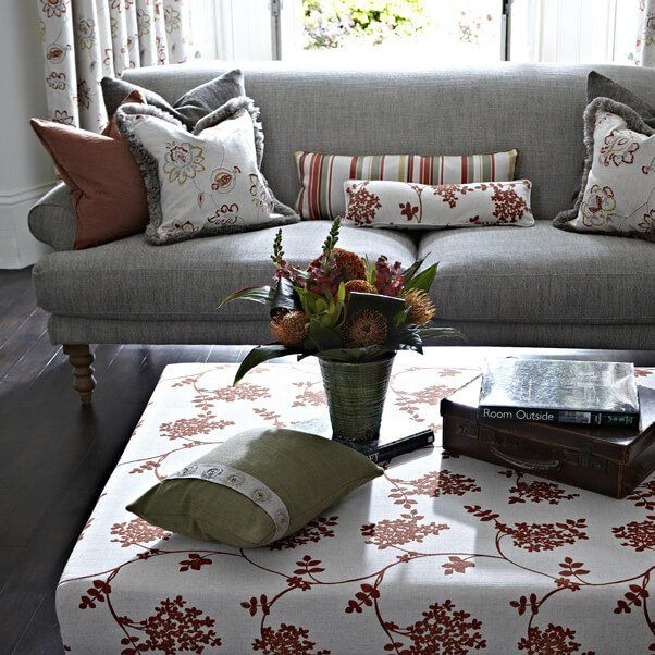 Cushions that match the curtains and table covering