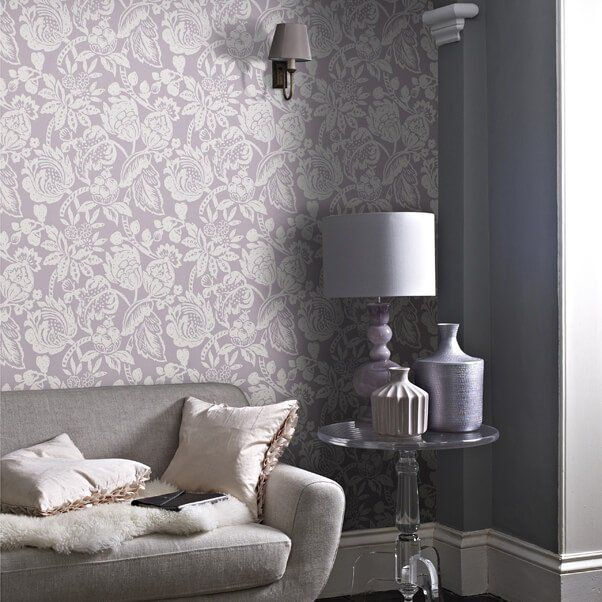 A room with fabric wallpaper