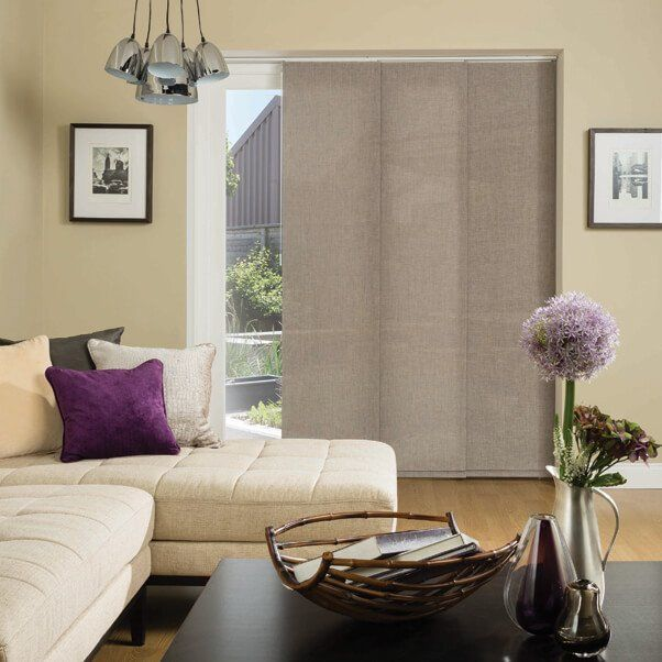 A living room with vertical blinds