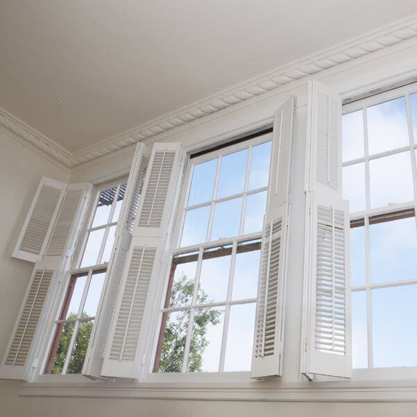 White interior window shutters, open