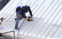 One of our roofing services team at work in Anchorage, AK