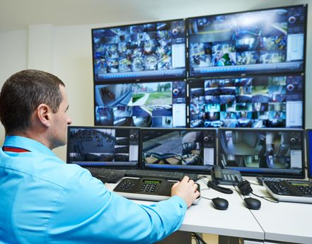Professional monitoring the various security cameras