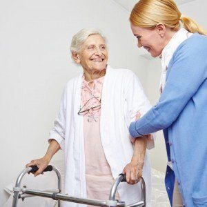 Nurse helping for senior woman