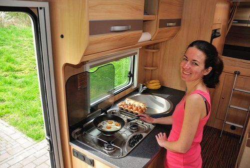 woman cooking in a motorhome
