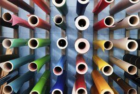 Different types of rolled paper on a rack
