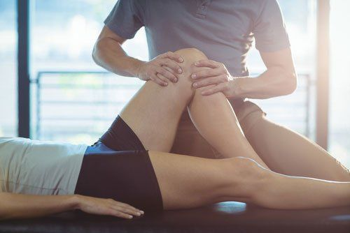 Knee treatment by physiotherapist