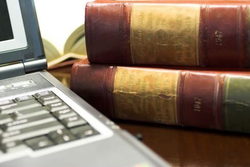 Two law books and a laptop