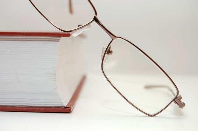 Legal book and spectacles used by attorrney in Russellville, AR