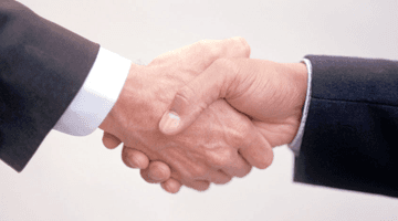 Immigration advice - Birmingham, West Midlands - Syeds Law Office Solicitors - shake hands