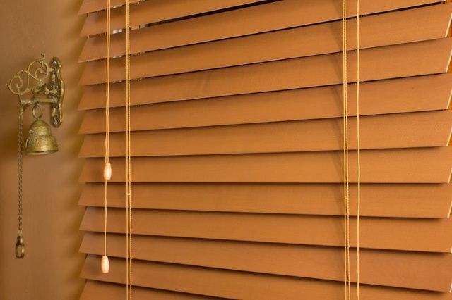 Home interior detail for drawn wooden blinds in AZ
