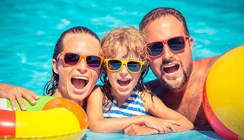 Family enjoying themselves in the pool