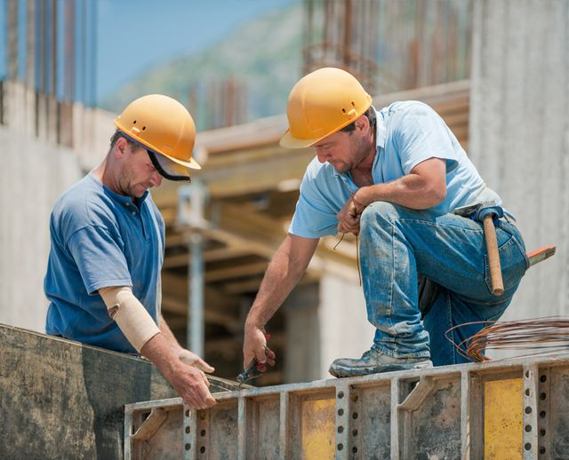 Two workers on constuction site