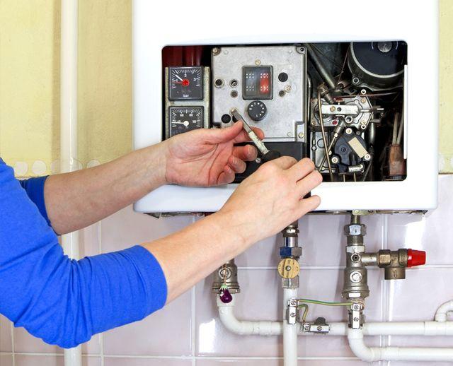 Man fixing heater