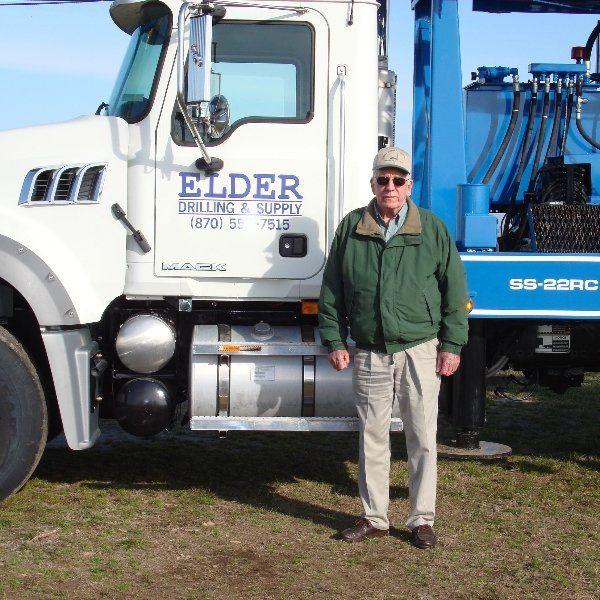 man standing by door of Elder truck