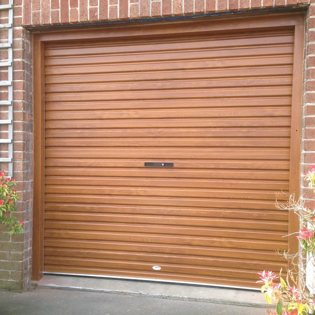 Garage door specialists at elite garage doors in comber for Garage screen door rollers